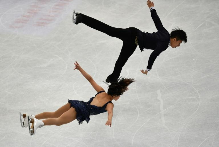 China's Sui Wenjing and Han Cong perform during the pairs short program of the ISU World Figure Skating Championships 2017 on March 29, 2017 in Helsinki