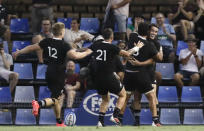 New Zealand's Will Jordan, right, is congratulated by teammates after scoring his second try during the Tri-Nations rugby test between Argentina and the All Blacks in Newcastle, Australia, Saturday, Nov. 28, 2020. (AP Photo/Rick Rycroft)