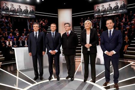 French presidential election candidates (LtoR) Francois Fillon, Emmanuel Macron, Jean-Luc Melenchon, Marine Le Pen and Benoit Hamon, pose before a debate organised by French private TV channel TF1 in Aubervilliers