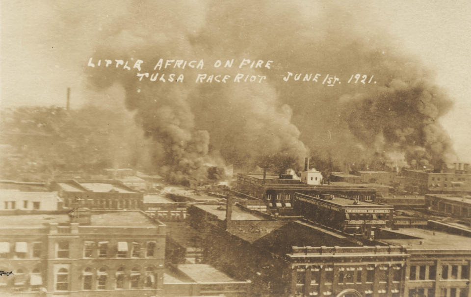 This postcard provided by the Department of Special Collections, McFarlin Library, The University of Tulsa shows fires burning during the Tulsa Race Massacre in Tulsa, Okla. on June 1, 1921. (Department of Special Collections, McFarlin Library, The University of Tulsa via AP)