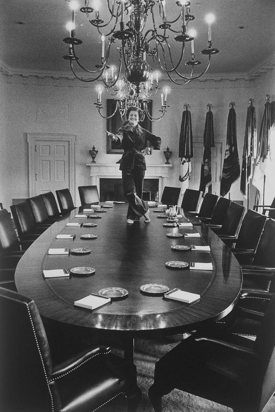 <p>File under: iconic first lady moments. Betty Ford made waves not only when she was captured on top of the presidential cabinet table, but also as one of the first women to don a pantsuit. </p>