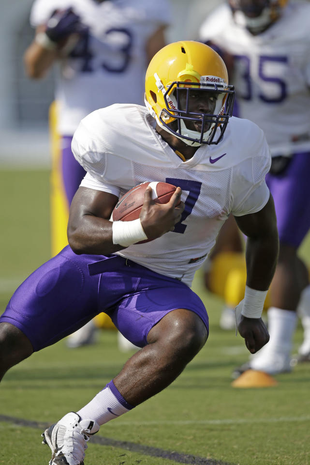 LSU freshman running back Leonard Fournette (7) runs through drills during their NCAA college football practice in Baton Rouge, La., Wednesday, Aug. 6, 2014. (AP Photo/Gerald Herbert)