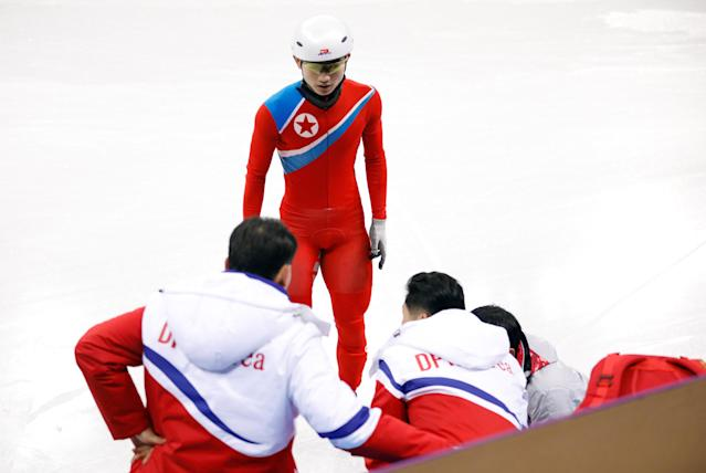 North Korea's short track speed skater Jong Kwang Bom looks on as Choe Un Song is assisted after an injury during a training session at the Gangneung Ice Arena in Gangneung, South Korea February 2, 2018. REUTERS/Kim Hong-Ji