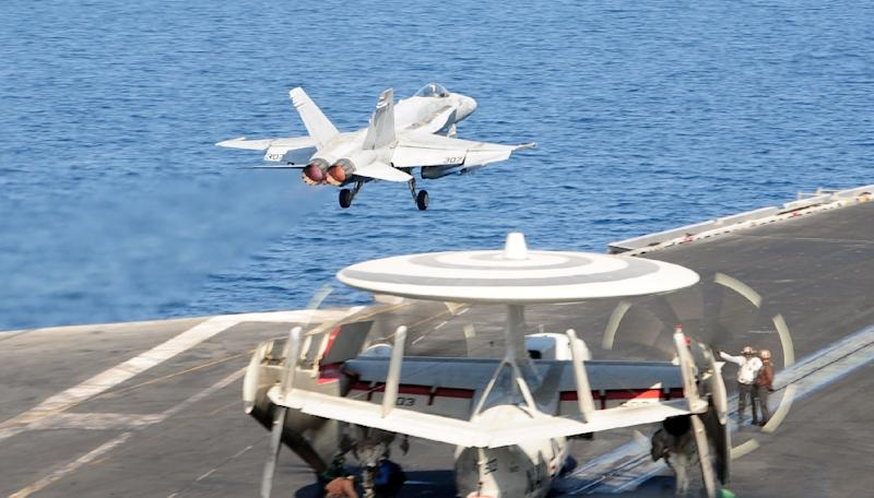An F/A-18C Hornet, attached to the Valions of Strike Fighter Squadron (VFA) 15, launches from  the flight deck of the aircraft carrier USS George H.W. Bush in The Gulf on October 10, 2014