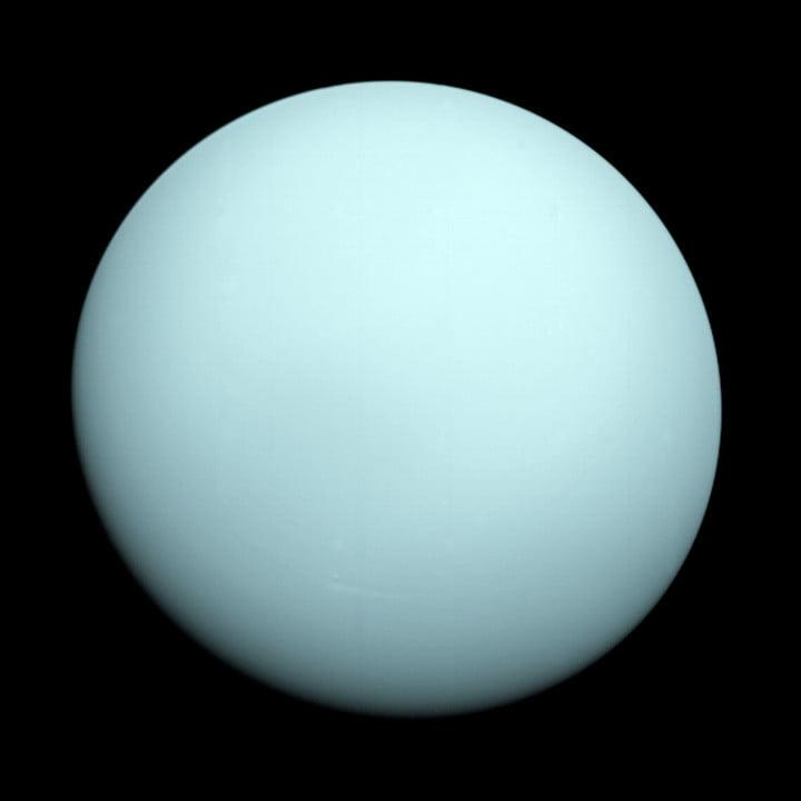 Voyager 2 took this image as it approached the planet Uranus on Jan. 14, 1986. The planet's hazy bluish color is due to the methane in its atmosphere, which absorbs red wavelengths of light.