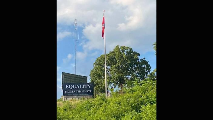 Amanda Burrows of Tuscumbia, Missouri, has raised $5,000 to fund an anti-racism message on a billboard near the base of a giant Confederate flag erected this past winter along a popular highway to the Lake of the Ozarks.