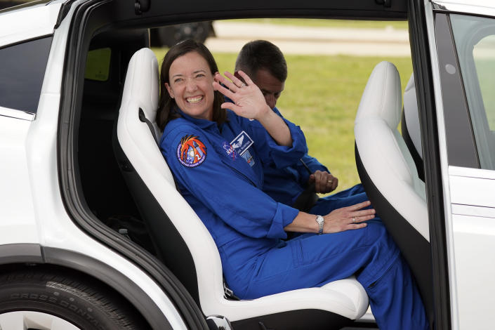 SpaceX Crew 2 member NASA astronaut Megan McArthur, front, waves as she leaves a news conference with NASA astronaut Shane Kimbrough, back, at the Kennedy Space Center in Cape Canaveral, Fla., Friday, April 16, 2021 as they prepare for a mission to the International Space Station. The launch is targeted for April 22. (AP Photo/John Raoux)