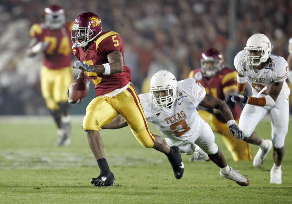 04 JAN 2006:  Reggie Bush (5) of the University of Southern California plays against the University of Texas during the BCS National Championship Game at the Rose Bowl in Pasadena, CA.  Texas defeated USC 41-38 for the national title.  Jamie Schwaberow/NCAA Photos via Getty Images