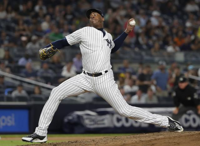 FILE - In this Aug. 14, 2018 file photo New York Yankees' Aroldis Chapman delivers a pitch during the ninth inning of a baseball game against the Tampa Bay Rays in New York. Chapman could return next week from nearly a month on the disabled list. He has not pitched since Aug. 21 because of left knee tendinitis, which has bothered him throughout the season. The 30-year-old left-hander threw a bullpen session Wednesday, Sept. 12, 2018 and was to return to New York for treatment. (AP Photo/Frank Franklin II, file)
