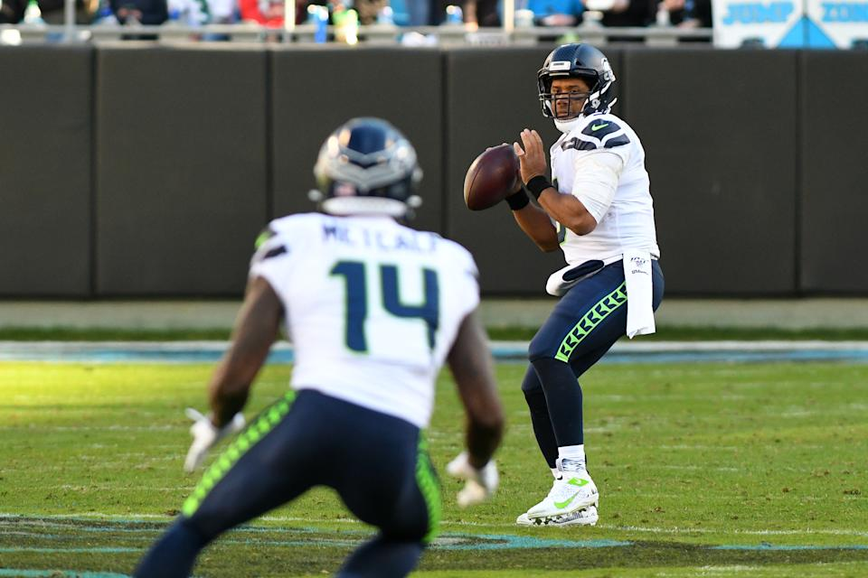 CHARLOTTE, NC - DECEMBER 15: Seattle Seahawks quarterback Russell Wilson (3) looks to pass to Seattle Seahawks wide receiver D.K. Metcalf (14) during the game between the Seattle Seahawks and the Carolina Panthers on December 15, 2019 at Bank of America Stadium in Charlotte,NC. (Photo by Dannie Walls/Icon Sportswire via Getty Images)