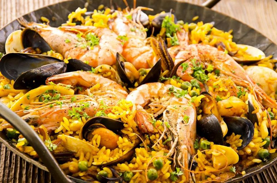"""This wasn't the year for a big paella party with a big communal pot, but you were still out there, making paella. And for that, we salute you. <a href=""""https://www.epicurious.com/recipes/food/views/seafood-paella-366249?mbid=synd_yahoo_rss"""" rel=""""nofollow noopener"""" target=""""_blank"""" data-ylk=""""slk:See recipe."""" class=""""link rapid-noclick-resp"""">See recipe.</a>"""