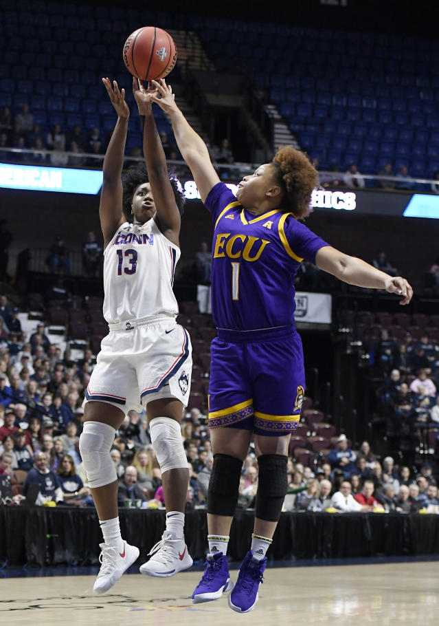 Connecticut's Christyn Williams shoots over East Carolina's Alex Frazier during the first half of an NCAA college basketball game in the American Athletic Conference tournament quarterfinals, Saturday, March 9, 2019, at Mohegan Sun Arena in Uncasville, Conn. (AP Photo/Jessica Hill)