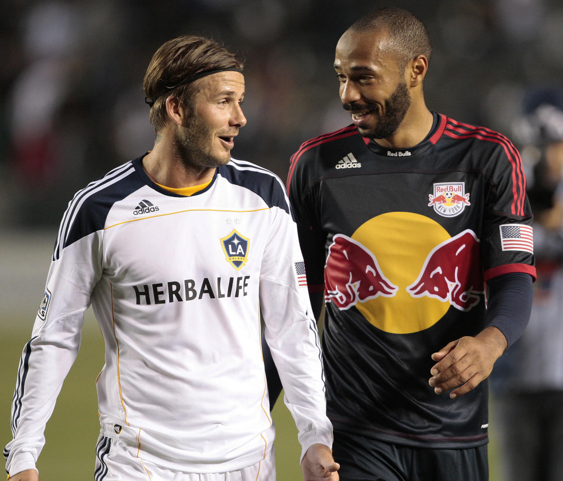 Los Angeles Galaxy's David Beckham, left, of England and New York Red Bulls' Thierry Henry of France talk as they walk off the field after their MLS soccer match, Saturday, May 7, 2011, in Carson, Calif. The game ended in a 1-1 tie.