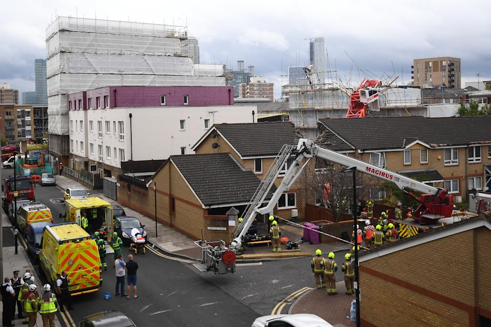 The scene in Bow, east London, where a 20-metre crane has collapsed on to a house leaving people trapped inside.