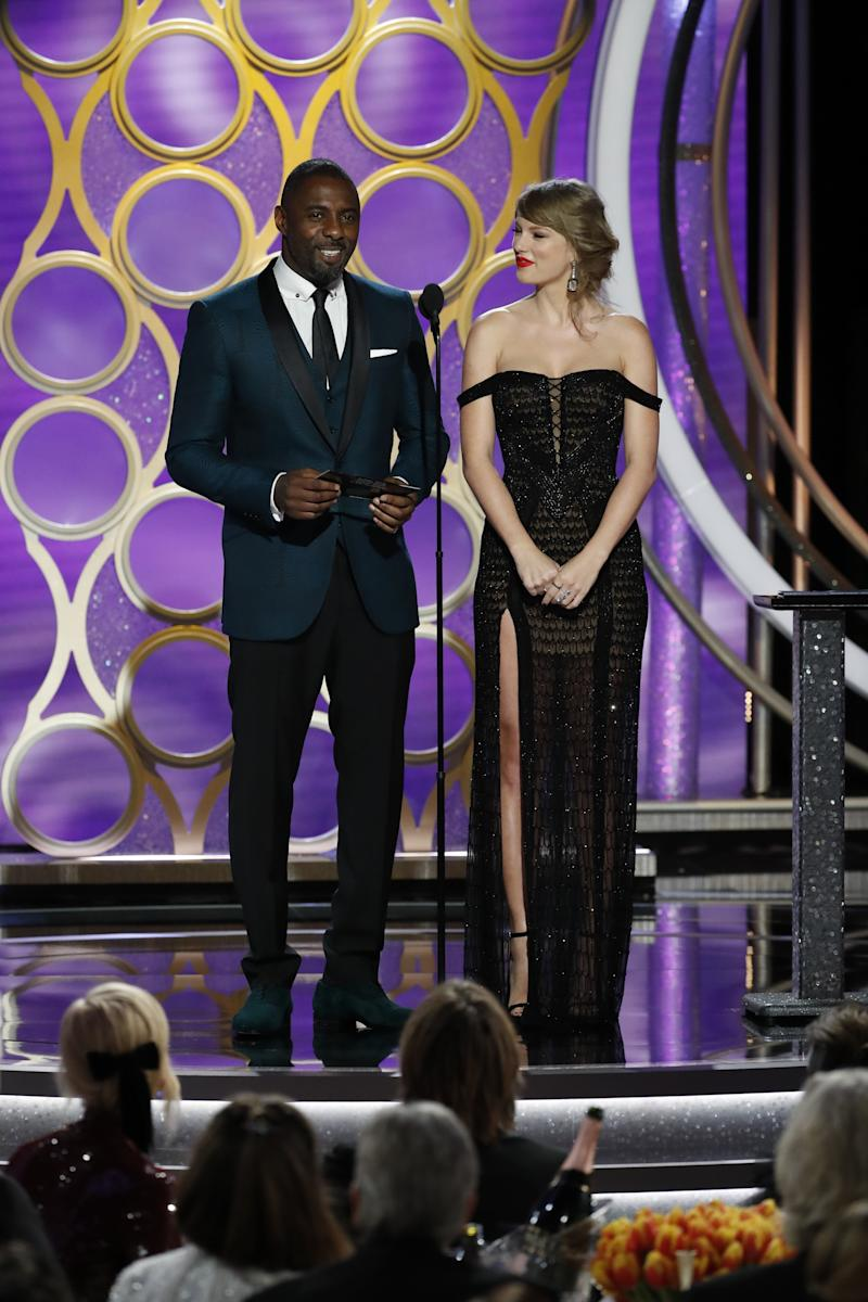 Presenters Taylor Swift and Idris Elba speak onstage during the 76th Annual Golden Globe Awards at The Beverly Hilton Hotel on January 06, 2019 in Beverly Hills, California. | Handout/NBCUniversal—Getty Images