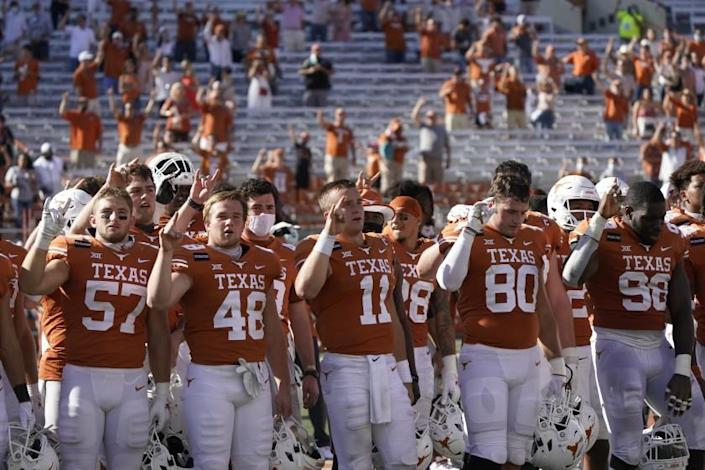 "Texas players sing ""The Eyes of Texas"" after a game against West Virginia on Nov. 7 in Austin."