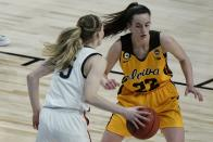 Iowa's Caitlin Clark defends UConn's Paige Bueckers during the second half of an NCAA college basketball game in the Sweet 16 round of the Women's NCAA tournament Saturday, March 27, 2021, at the Alamodome in San Antonio. (AP Photo/Morry Gash)