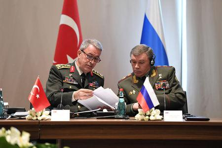 Turkey's Chief of Staff General Hulusi Akar chats with Russian Armed Forces Chief of Staff Valery Gerasimov during a meeting in Antalya, Turkey March 7, 2017. Turkish Military/Handout via REUTERS