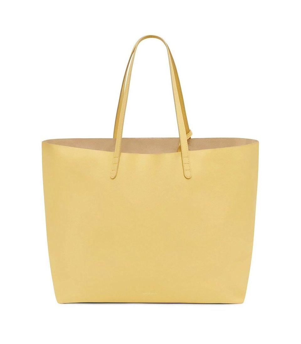 """<p><strong>Mansur Gavriel</strong></p><p>ShopBAZAAR.com</p><p><strong>$695.00</strong></p><p><a href=""""https://go.redirectingat.com?id=74968X1596630&url=https%3A%2F%2Fshop.harpersbazaar.com%2Fdesigners%2Fmansur-gavriel%2Foversized-tote-in-spiga-64602.html&sref=https%3A%2F%2Fwww.harpersbazaar.com%2Ffashion%2Fg31944159%2Fmothers-day-gifts-from-daughters%2F"""" rel=""""nofollow noopener"""" target=""""_blank"""" data-ylk=""""slk:Shop Now"""" class=""""link rapid-noclick-resp"""">Shop Now</a></p><p>Introduce spring to her wardrobe with this effortless tote that carries it all. No matter what her day brings, she'll be fully prepared when she has a bag like this by her side.</p>"""