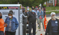 Voters line up at Northwood Elementary before the polls open for the primary election Tuesday, June 2, 2020 in Baltimore. (Jerry Jackson/The Baltimore Sun via AP)