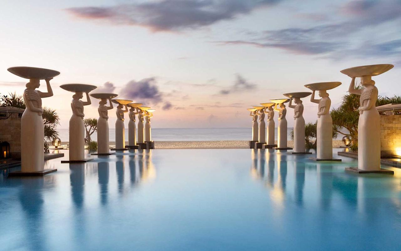 "<p><strong>Why it's cool:</strong> There are several pools at <a href=""https://www.themulia.com"">The Mulia Villas</a>, but the oceanfront infinity Oasis Pool is easily the most stunning. The beautifully crafted statues of Balinese women carrying daily offerings create an environment of serenity — and the views of the Indian Ocean are hard to top.</p>"