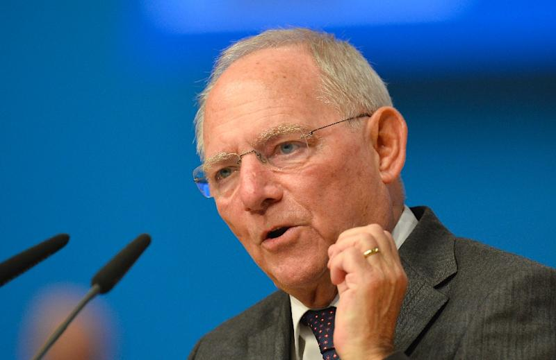 German Finance Minister Wolfgang Schaeuble talks to the delegates during the annual federal congress of the German Christian Union (CDU) in Karlsruhe, southern Germany, on December 14, 2015 (AFP Photo/Thomas Kienzle)