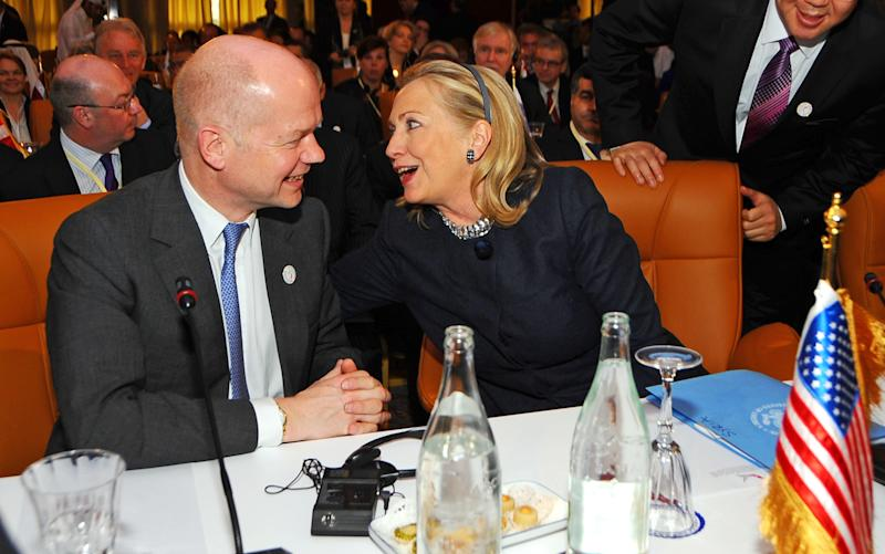 US Secretary of State Hillary Rodham Clinton sits next to British foreign minister William Hague, left, at the start of the Conference on Syria in Tunis, Tunisia, Friday Feb. 24, 2012. The birthplace of the Arab Spring is hosting a landmark conference on Syria by high-level U.S., European, Turkish and Arab League officials. (AP Photo/Hassene Dridi)