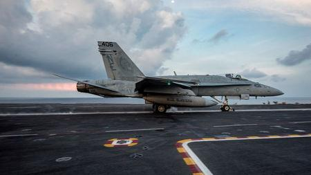 An F/A-18C Hornet launches from the aircraft carrier USS Carl Vinson