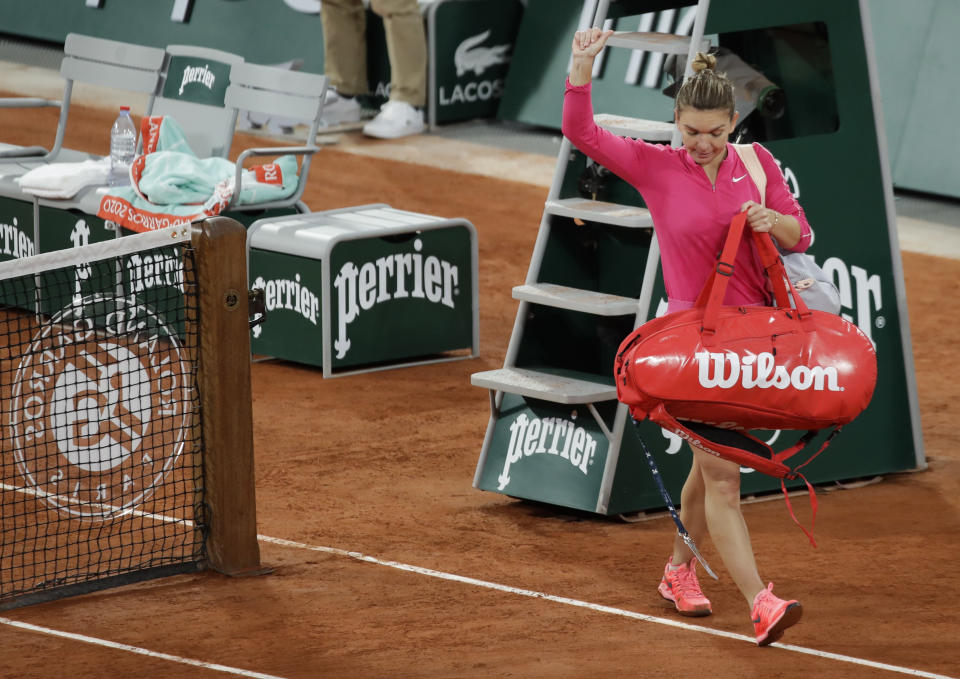 Romania's Simona Halep leaves after losing her fourth round match of the French Open tennis tournament against Poland's Iga Swiatek at the Roland Garros stadium in Paris, France, Sunday, Oct. 4, 2020. (AP Photo/Alessandra Tarantino)