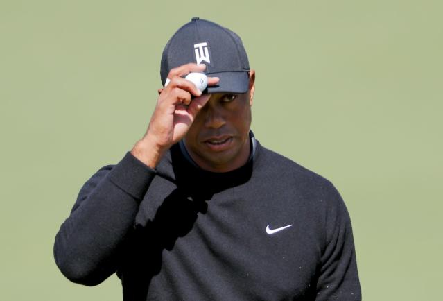 "<a class=""link rapid-noclick-resp"" href=""/pga/players/147/"" data-ylk=""slk:Tiger Woods"">Tiger Woods</a> reacts after putting on the second hole during the first round at the Masters golf tournament Thursday, April 5, 2018, in Augusta, Ga. (AP Photo/David Goldman)"