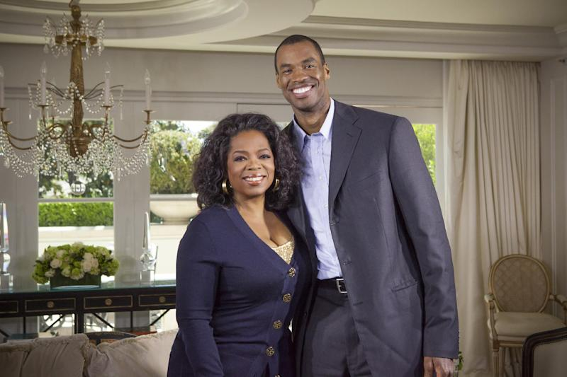 "This May 1, 2013 photo released by OWN shows host Oprah Winfrey posing with NBA  basketball player Jason Collins during an interview for ""Oprah's Next Chapter,"" in Beverly Hills, Calif.  The interview aired Sunday. Officials at three publishing houses said Monday, May 6, that they had been contacted about a planned memoir by Collins, the first active player in any of four major U.S. professional sports leagues to come out as gay.  (AP Photo/OWN, Chuck Hodes)"