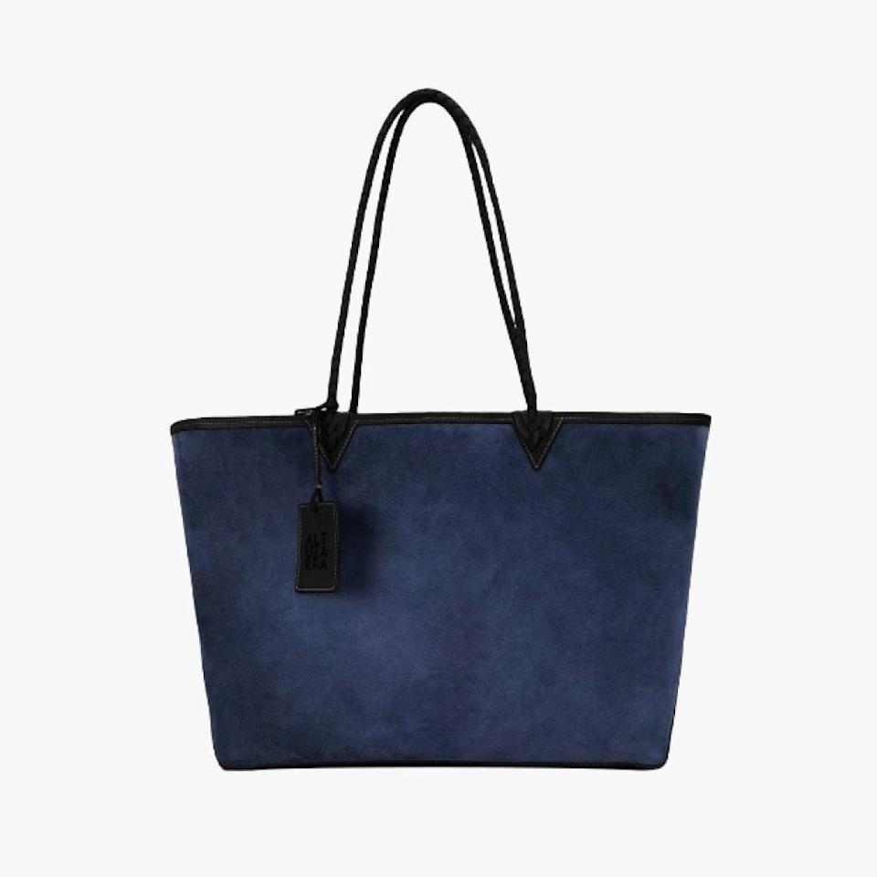 "Altuzarra's reversible tote features blue suede on one side and natural canvas on the reverse side, which you can DIY with the colored sharpies included in the carryall. Part of the proceeds from the sales of this bag will go to <a href=""https://secure.nokidhungry.org/site/Donation2?df_id=18770&mfc_pref=T&18770.donation=form1&s_src=googlemain&s_subsrc=210HAGN1&utm_source=google&utm_medium=search&utm_campaign=2020_brand&utm_content=paid"" rel=""nofollow noopener"" target=""_blank"" data-ylk=""slk:No Kid Hungry"" class=""link rapid-noclick-resp"">No Kid Hungry</a>, a non-profit that helps ensure children suffering from food insecurity receive daily meals. $1195, ALTUZARRA. <a href=""https://www.altuzarra.com/en-us/shopping/item-15750338"" rel=""nofollow noopener"" target=""_blank"" data-ylk=""slk:Get it now!"" class=""link rapid-noclick-resp"">Get it now!</a>"
