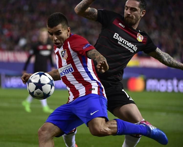 Atletico Madrid's forward Angel Correa (L) vies with Leverkusen's defender Roberto Hilbert during the UEFA Champions League round of 16 second leg football match March 15, 2017