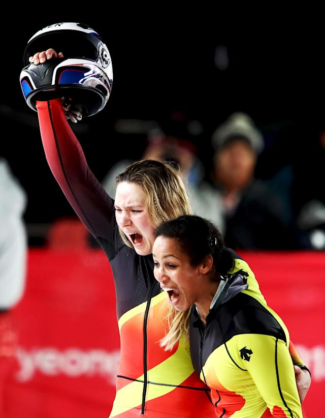 <p>Gold medalists Mariama Jamanka and Lisa Buckwitz of Germany celebrate in the finish area during the Women's Bobsleigh heats at the PyeongChang 2018 Winter Olympic Games on February 21, 2018.<br> (Photo by Clive Mason/Getty Images) </p>