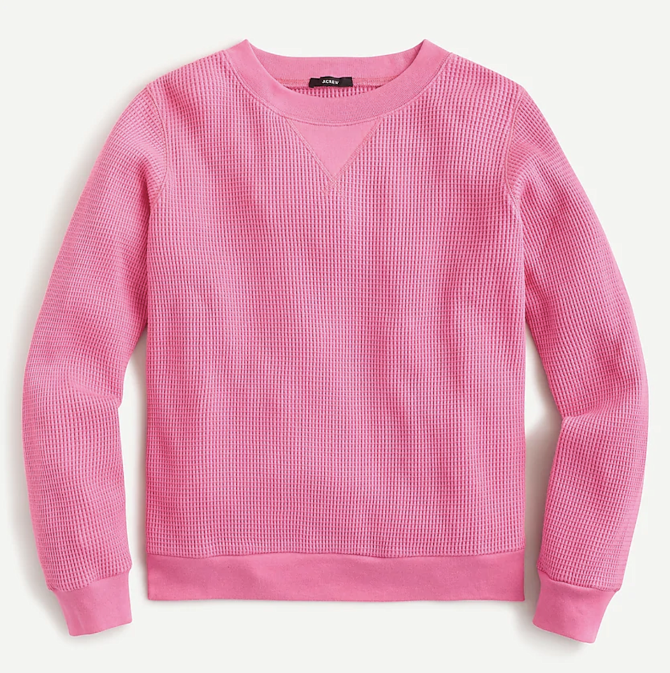 """<p>While you can certainly layer this J. Crew Waffle Crewneck Pullover under another top, the vibrant color and slightly thicker material are enough to provide a level of warmth and easy style that's strong on its own. The matching <a href=""""https://shop-links.co/1726218805983826033"""" rel=""""nofollow noopener"""" target=""""_blank"""" data-ylk=""""slk:Waffle Joggers"""" class=""""link rapid-noclick-resp"""">Waffle Joggers</a> make it a quick and super casual full indoor outfit. </p> <p><strong>Sizes available:</strong> XXS to 3X</p> <p><strong>$70</strong> (<a href=""""https://shop-links.co/1726218783568971223"""" rel=""""nofollow noopener"""" target=""""_blank"""" data-ylk=""""slk:Shop Now"""" class=""""link rapid-noclick-resp"""">Shop Now</a>)</p>"""