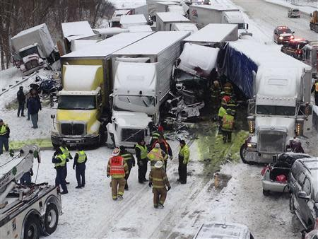 Trucks and passenger vehicles block eastbound Interstate 94 following a massive crash that killed three people and injured about 20 near Michigan City, Indiana January 23, 2014. REUTERS/Indiana State Police/Handout