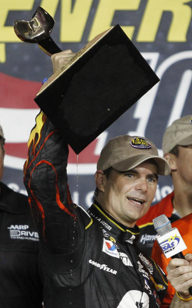 NASCAR driver Jeff Gordon celebrates in victory lane after winning the Sprint Cup Series auto race at Kansas Speedway in Kansas City, Kan., Saturday, May 10, 2014. (AP Photo/Colin E. Braley)