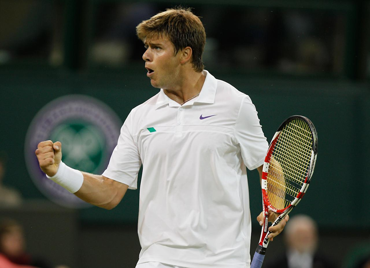 LONDON, ENGLAND - JUNE 27:  Ryan Harrison of USA celebrates a point during his Gentlemen's Singles second round match against Novak Djokovic of Serbia on day three of the Wimbledon Lawn Tennis Championships at the All England Lawn Tennis and Croquet Club on June 27, 2012 in London, England.  (Photo by Paul Gilham/Getty Images)