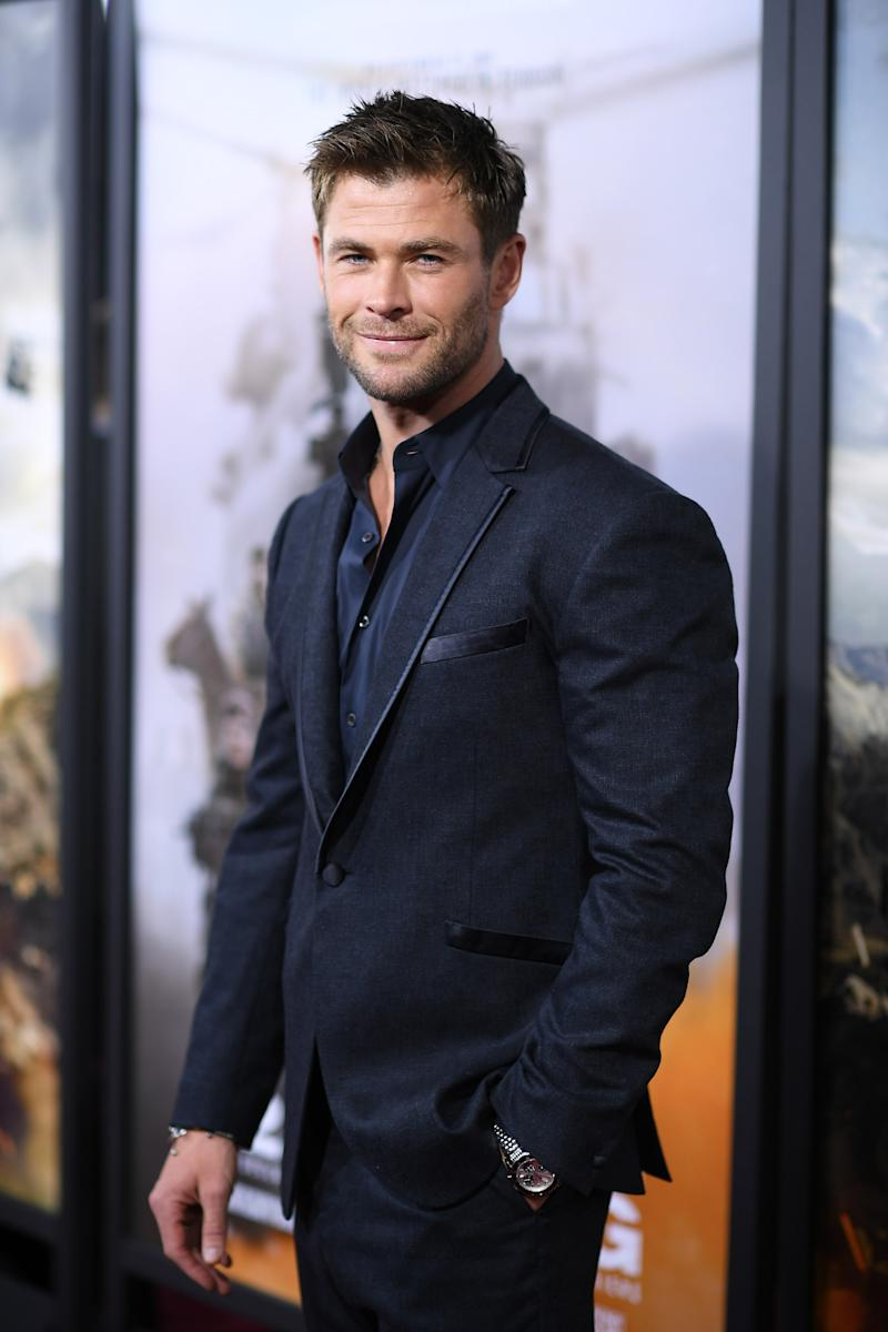 Chris Hemsworth poses on the red carpet