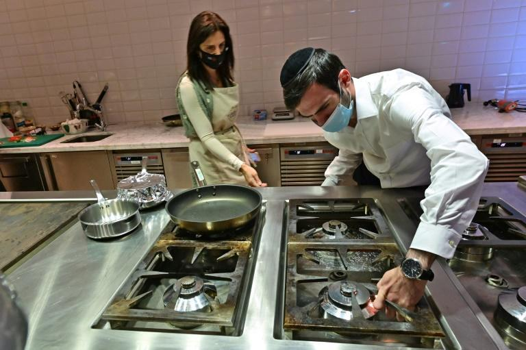 Rabbi Yaakov Eisenstein (R) supervises the preparation of food at Elli's Kosher Kitchen, set up two years ago to enable Jewish travellers to remain observant while visiting the UAE