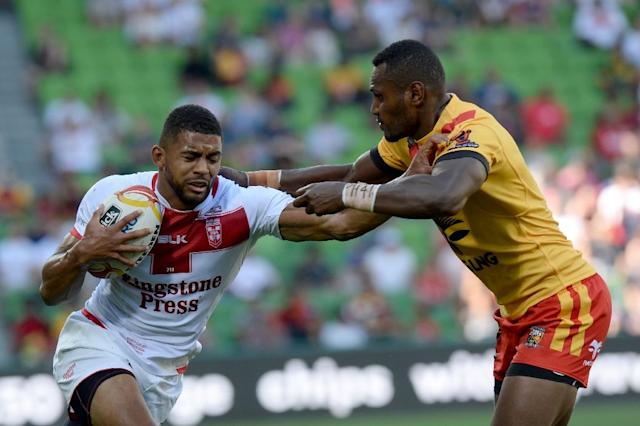 Severe heatstroke may have caused the sudden death of Papua New Guinea rising star Kato Ottio (R), pictured here during the 2017 Rugby League World Cup match against England, in Melbourne, on November 19 (AFP Photo/Mal Fairclough)