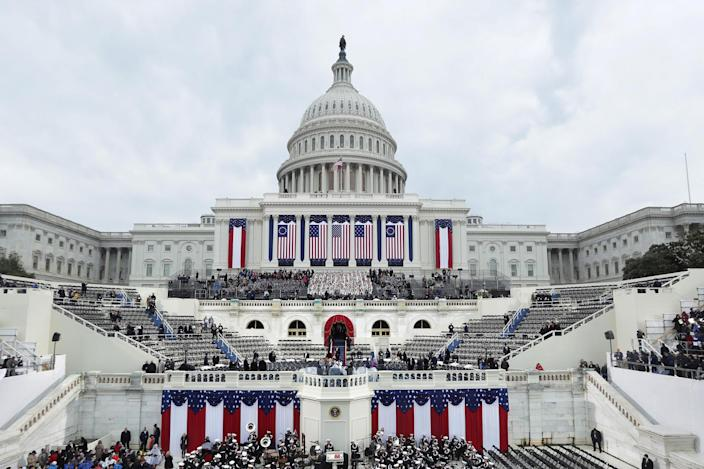 <p>Spectators begin to fill seats for the inauguration on the West Front of the U.S. Capitol on January 20, 2017 in Washington. (Photo: Alex Wong/Getty Images) </p>