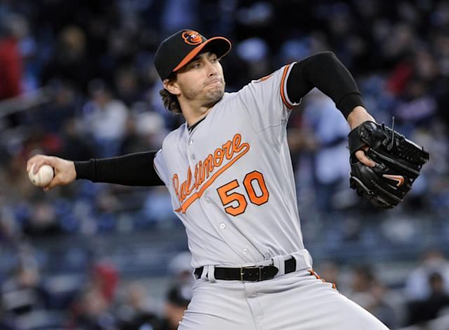 Baltimore Orioles pitcher Miguel Gonzalez delivers the ball to the New York Yankees during the first inning of a baseball game Wednesday, April 9, 2014, at Yankee Stadium in New York. (AP Photo/Bill Kostroun)