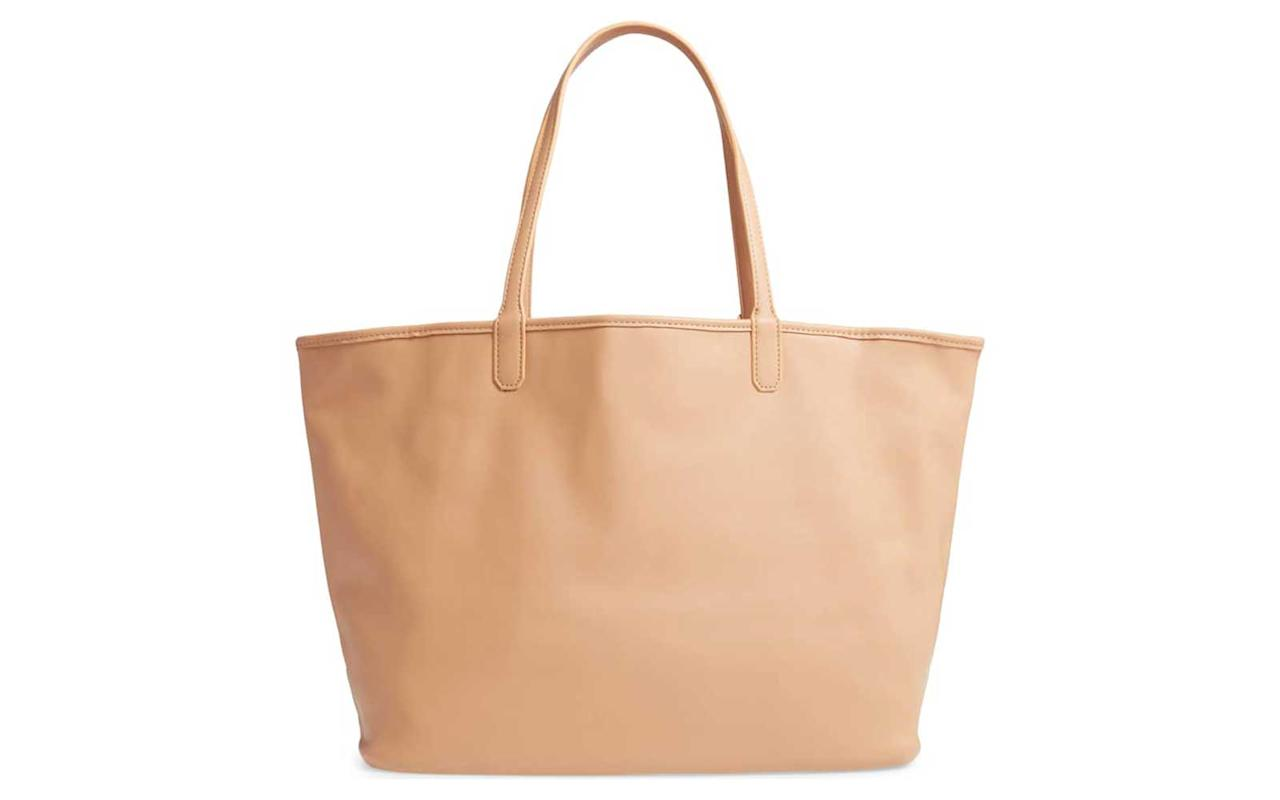"""<p>This reversible Mali + Lily tote can be taken from a business meeting to the beach. Wear it with the sleek vegan leather on the outside, then reverse it for a tropical style fit for the sand.</p> <p>To buy: <a href=""""https://click.linksynergy.com/deeplink?id=93xLBvPhAeE∣=1237&murl=http%3A%2F%2Fshop.nordstrom.com%2Fs%2Fmali-lili-reversible-vegan-leather-tote%2F5206092&u1=TL,9StylishVeganLeatherBagsThatLookLiketheRealThing,chenk,TRA,GAL,753769,201903,I"""" target=""""_blank"""">nordstrom.com</a>, $78</p>"""