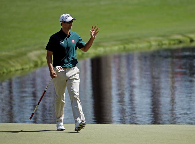Adam Scott, of Australia, waves after putting on the 16th hole during the first round of the Masters golf tournament Thursday, April 10, 2014, in Augusta, Ga. (AP Photo/Matt Slocum)
