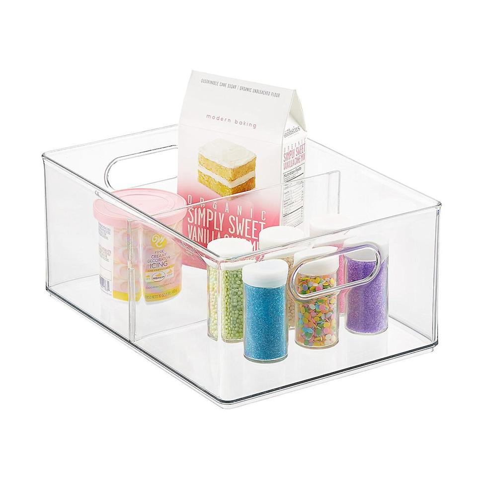 "<h3>Use clear bins to group items together</h3><br>""For a busy lifestyle, bins tend to be easier to maintain. They can hold dry snacks (crackers, popcorn, granola bars, chip bags), beverages, canned items, condiments, and more specific categories.""<br><br><strong>The Home Edit</strong> All-Purpose Deep Bin with Divider, $, available at <a href=""https://go.skimresources.com/?id=30283X879131&url=https%3A%2F%2Fwww.containerstore.com%2Fs%2Fkitchen%2Fthe-home-edit-collection%2Fthe-home-edit-all-purpose-deep-bin-with-divider%2F12d%3FproductId%3D11010525"" rel=""nofollow noopener"" target=""_blank"" data-ylk=""slk:The Container Store"" class=""link rapid-noclick-resp"">The Container Store</a><br><br><strong>The Home Edit</strong> All-Purpose Bin, $, available at <a href=""https://go.skimresources.com/?id=30283X879131&url=https%3A%2F%2Fwww.containerstore.com%2Fs%2Fkitchen%2Fthe-home-edit-collection%2Fthe-home-edit-all-purpose-bin%2F12d%3FproductId%3D11010524"" rel=""nofollow noopener"" target=""_blank"" data-ylk=""slk:The Container Store"" class=""link rapid-noclick-resp"">The Container Store</a><br><br><strong>mDesign</strong> Plastic Kitchen Storage Bins with Handles - 4 Pack, $, available at <a href=""https://www.amazon.com/mDesign-Kitchen-Cabinet-Storage-Organizer/dp/B06XH9FNH1/"" rel=""nofollow noopener"" target=""_blank"" data-ylk=""slk:Amazon"" class=""link rapid-noclick-resp"">Amazon</a>"