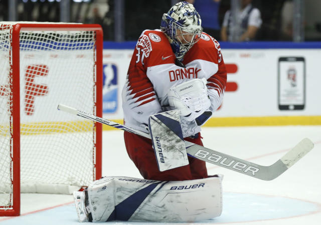 Denmark's Frederik Andersen makes a save during the Ice Hockey World Championships group B match between Denmark and Latvia at the Jyske Bank Boxen arena in Herning, Denmark, Tuesday, May 15, 2018. (AP Photo/Petr David Josek)