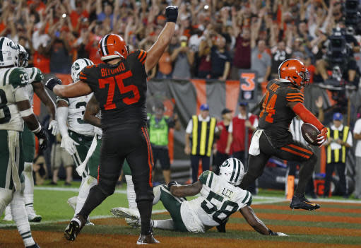 Cleveland Browns running back Carlos Hyde (34) rushes for a 1-yard touchdown during the second half of an NFL football game against the New York Jets, Thursday, Sept. 20, 2018, in Cleveland. (AP Photo/Ron Schwane)