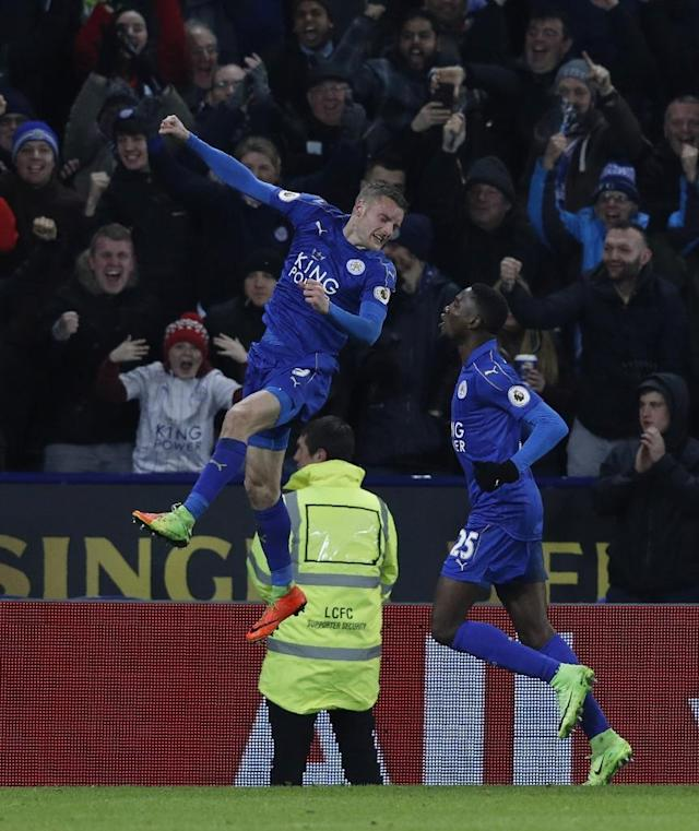 Leicester City's Jamie Vardy (L) celebrates after scoring a goal with teammate Wilfred Ndidi during their English Premier League match against Liverpool, at King Power Stadium in Leicester, on February 27, 2017 (AFP Photo/Adrian Dennis)