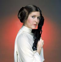 No Merchandising. Editorial Use Only. No Book Cover Usage. Mandatory Credit: Photo by Lucasfilm/20th Century Fox/REX/Shutterstock (5886297ew) Carrie Fisher Star Wars Episode IV - A New Hope - 1977 Director: George Lucas Lucasfilm/20th Century Fox USA Film Portrait Scifi Star Wars (1977) La Guerre des étoiles
